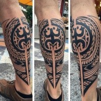 Typical black ink leg tattoo of Polynesian ornaments