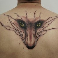 Typical black ink upper back tattoo of fox face