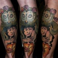Typical colored leg tattoo of woman portrait with owl and flower