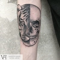 Typical designed by Valentin Hirsch forearm tattoo of Leopard and human skull
