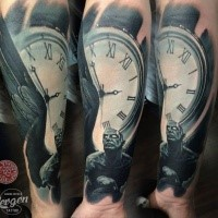 Typical multicolored forearm tattoo of old clock with angel