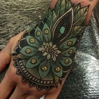 Typical old school style colored hand tattoo of big flower
