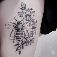 Typical Zihwa style blackwork tattoo of bee with flowers