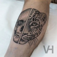 Unbelievable painted by Valentin Hirsch leg tattoo of split human skull with leopard head