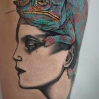 Unfinished and colored tattoo of woman head with big lizard