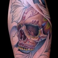 Unfinished half colored Mexican traditional style human skull tattoo combined with flowers