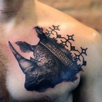 Unique black ink chest tattoo of rhino head with medieval ornaments