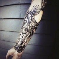 Unique black ink mystic coffin with eye and wing tattoo on arm