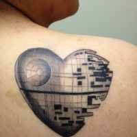 Unique designed black ink on shoulder tattoo of heart shaped Death Star