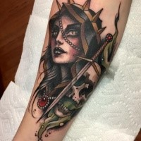 New school style colored forearm tattoo of creepy woman with skull and sword by Michael J Kelly