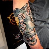 New school style colored arm tattoo of colored leopard with feather