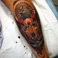 New school style colored leg tattoo of animal skull with eagle and anchor