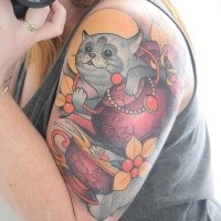 Illustrative style colored shoulder tattoo of lucky cat with flowers and cup