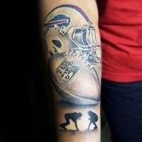 Illustrative style colored arm tattoo of American game helmet with ball