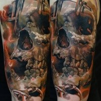 New school style colored shoulder tattoo of big human skull with vine
