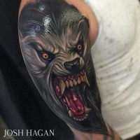 New school style colored shoulder tattoo of evil looking wolverine