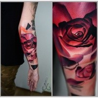 New school style colored arm tattoo of big red rose with ornaments