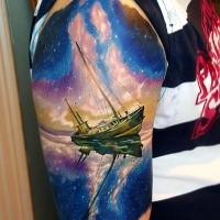 Illustrative style colored shoulder tattoo of old sailing ship