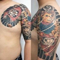 Illustrative style colored shoulder tattoo of big daruma dolls and fantasy tiger