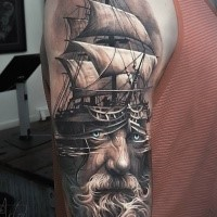 New school style colored shoulder tattoo of large sailing ship with old sad man