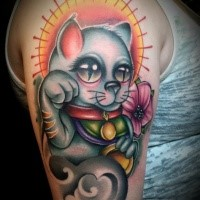 New school style colored shoulder tattoo of maneki neko japanese lucky cat with sun and flowers
