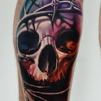New school style colored leg tattoo of human skull with vine