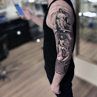Unusual black and white sleeve tattoo of various angel statues