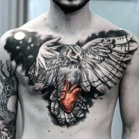 Unusual combined realistic owl tattoo on chest with human heart and moon