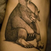 Unusual designed black and white animal tattoo on side