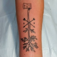 Unusual designed black ink axe tattoo on forearm with crossed arrow and leaves
