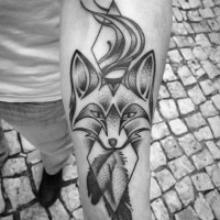 Unusual designed black ink mystic fox tattoo on forearm stylized with geometrical figures and feather