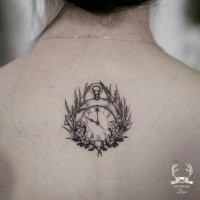 Unusual designed by Zihwa tattoo on upper back of clock with flowers