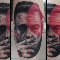 Unusual designed colored smoking man portrait with red ring tattoo on forearm