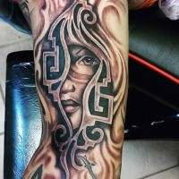 Unusual designed half sleeve tattoo of tribal woman portrait with steamy ornaments