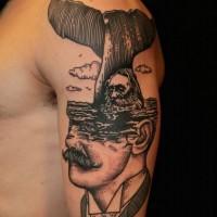 Unusual style painted half portrait half nautical tattoo on shoulder area