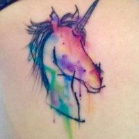 Unusual unicorn rainbow colored tattoo in watercolor style