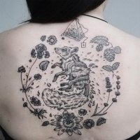 Usual black ink back tattoo of fox with plant and tea bag