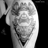 Usual black ink shoulder tattoo of animal skull with flowers