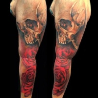 Usual combined red rose tattoo on sleeve with human skull