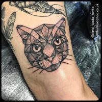 Usual dot style arm tattoo of creepy cat face