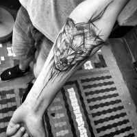 Usual linework style forearm sketch tattoo by Inez Janiak of wolf head