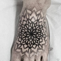 Usual simple looking dot style foot tattoo of big flowers