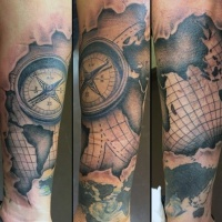 Usual style black ink nautical map with compass tattoo on arm