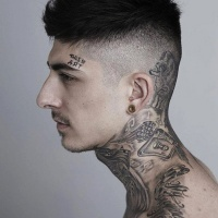 Various tattoos on whole body and lettering on forehead