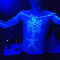 Very beautiful black light tree on the chest tattoo