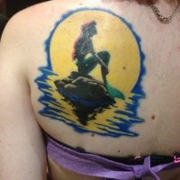 Very beautiful colored cartoon mermaid sitting on rock back tattoo with big yellow moon