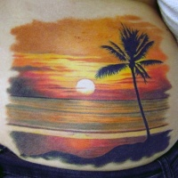 Very beautiful ocean sunset with lonely palm tree tattoo on waist