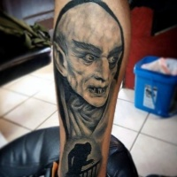 Very cool black ink old horror movie vampire tattoo on leg