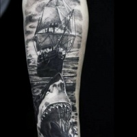 Very detailed black and white forearm tattoo of shark and pirate sailing ship