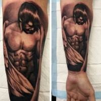 Very detailed black ink angel boy tattoo on forearm